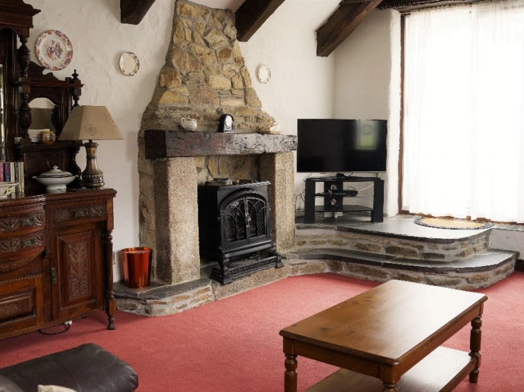 Traditional Stone Fireplace in Badgers Sett Holiday Cottage Newquay
